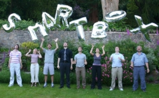 Smartbox staff with balloons that spell out Smartbox.